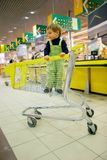 Boy in supermarket Stock Photos