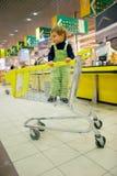 Boy in supermarket Stock Photos
