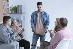 Boy and support group. Teenage boy talking in front of support group stock photography