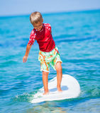 Boy with surf. Little boy with surf board learning surfing Stock Photos