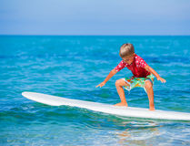 Boy with surf. Little boy with surf board learning surfing Stock Image