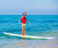 Boy with surf. Little boy with surf board learning surfing Royalty Free Stock Image