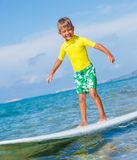 Boy with surf Stock Image