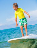Boy with surf. Little boy with surf board learning surfing Royalty Free Stock Photos