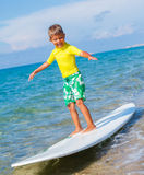 Boy with surf Royalty Free Stock Photos