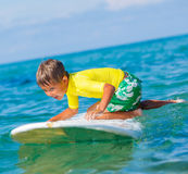 Boy with surf. Little boy with surf board learning surfing Stock Photography