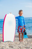 Boy with surf. Little cute boy with surf board on the beach Royalty Free Stock Photo