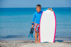 Boy with surf. Little cute boy with surf board learning surfing Stock Photography