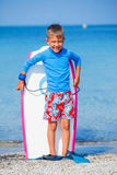 Boy with surf. Little cute boy with surf board learning surfing Stock Image