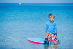 Boy with surf. Little cute boy with surf board learning surfing Stock Images