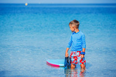 Boy with surf. Little cute boy with surf board learning surfing Stock Photos