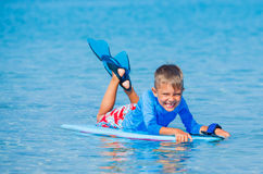 Boy with surf. Little cute boy with surf board learning surfing Stock Photo