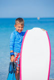 Boy with surf. Little cute boy with surf board learning surfing Royalty Free Stock Images