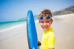 Boy with surf Stock Photography