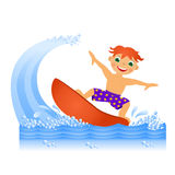 Boy on surfboard Stock Photos