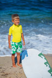 Boy with surfboard Stock Photography