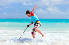 Boy surfing Stock Photo