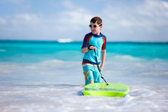 Boy surfing Stock Photography