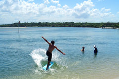 Boy Surfing. On a small board royalty free stock images