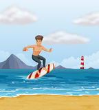 A boy surfing at the beach Stock Photo