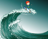 A boy surfing with big waves Royalty Free Stock Images