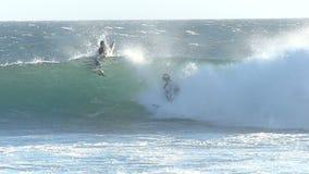 A Boy Surfing a Good Wave in California. 12 year old surfer, Zealand Hunter, rides a tubing wave near Santa Cruz, California stock footage
