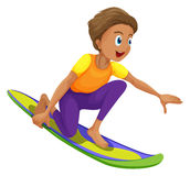 A boy surfing Royalty Free Stock Image