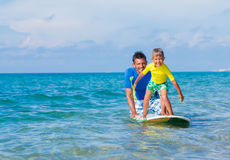 Boy surfing. Little boy with his father learning surfing Royalty Free Stock Photos