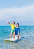 Boy surfing Royalty Free Stock Photo