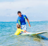 Boy surfing Royalty Free Stock Photography