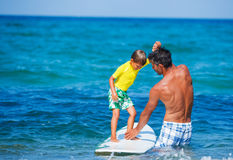 Boy surfing Royalty Free Stock Photos