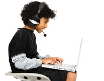 Boy Surfing The Net. With headset and smiling isolated over white Stock Photography