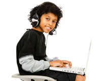 Boy Surfing The Net. Isolated over white stock photography