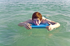 Boy surfing in the sea Royalty Free Stock Photography