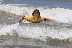 Boy surfing Stock Photo