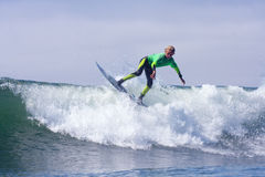 Boy Surfing on a Wave in Santa Cruz California Royalty Free Stock Images