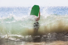 Boy surfing in the waves royalty free stock photography