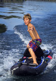 Boy Surfs Kayak - Boat Tow Royalty Free Stock Photos