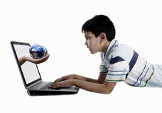 Boy surprised by a globe Stock Photography