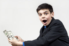 Boy surprised by the money received Stock Photo