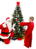Boy Surprises Santa Claus royalty free stock image
