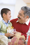 Boy Surprising Father With Christmas Present Stock Photos
