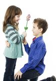 Boy surprising girl with flowers Royalty Free Stock Images