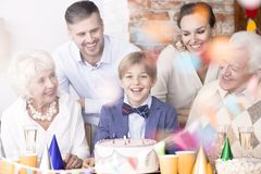 Boy surrounded by family royalty free stock photos