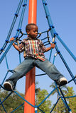 Boy Suspended on Ropes Stock Image