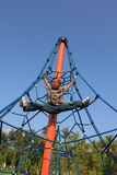 Boy Suspended on Ropes Stock Photography