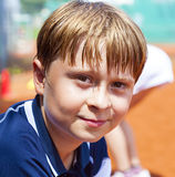 Boy with sweaty face after a tennis match Stock Images