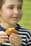 Boy with a sweet treat Royalty Free Stock Image
