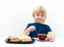 Boy with sweets Stock Photos