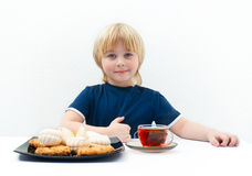 Boy with sweets Royalty Free Stock Photo